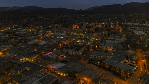 DXP002_132_0005 - Aerial stock photo of A view across downtown to cathedral at night, Santa Fe, New Mexico