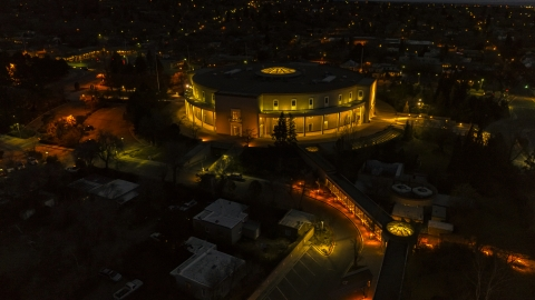 DXP002_132_0006 - Aerial stock photo of The New Mexico State Capitol at night, Santa Fe, New Mexico