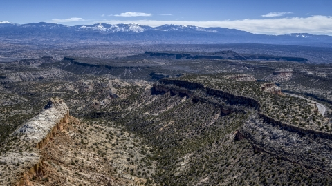 DXP002_133_0011 - Aerial stock photo of Flat desert mesas and distant mountains in New Mexico