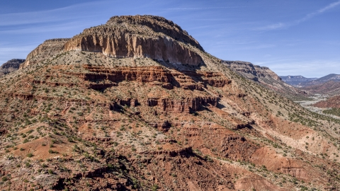 DXP002_135_0005 - Aerial stock photo of The side of a tall butte with steep slopes, New Mexico