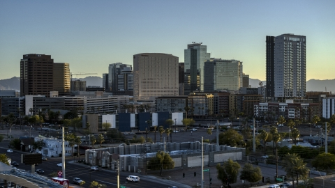 DXP002_138_0012 - Aerial stock photo of A hotel and tall office buildings at sunset in Downtown Phoenix, Arizona