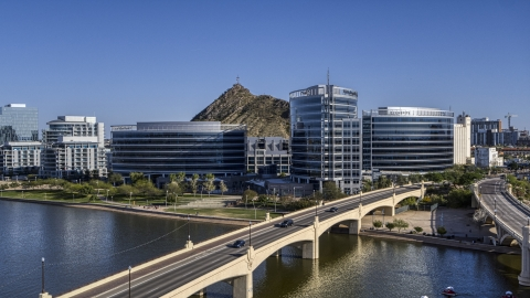 DXP002_142_0002 - Aerial stock photo of A view of modern office buildings by the reservoir in Tempe, Arizona