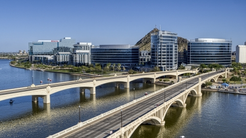 DXP002_142_0005 - Aerial stock photo of Bridges leading to waterfront office buildings in Tempe, Arizona