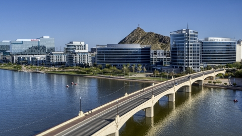 DXP002_142_0006 - Aerial stock photo of Modern office buildings near a bridge over a reservoir in Tempe, Arizona