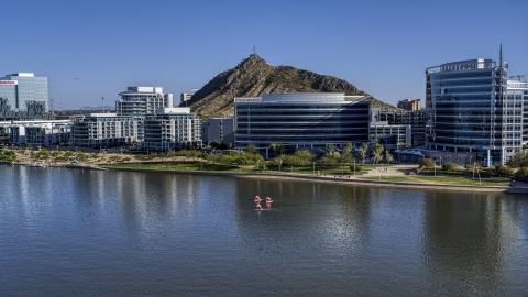 DXP002_142_0007 - Aerial stock photo of A riverfront condominium complex and modern office buildings in Tempe, Arizona