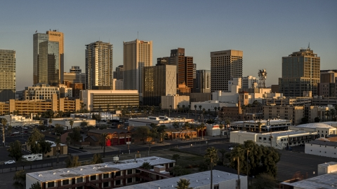 DXP002_143_0006 - Aerial stock photo of A view of the tall office buildings in the city's skyline at sunset, Downtown Phoenix, Arizona