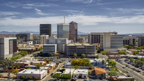 DXP002_144_0003 - Aerial stock photo of A view of a group of tall high-rise office buildings, Downtown Tucson, Arizona