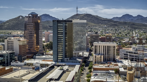 DXP002_144_0005 - Aerial stock photo of Three office towers with Sentinel Peak behind them, Downtown Tucson, Arizona