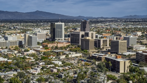 DXP002_144_0009 - Aerial stock photo of A pair of tall high-rise office towers and city buildings in Downtown Tucson, Arizona