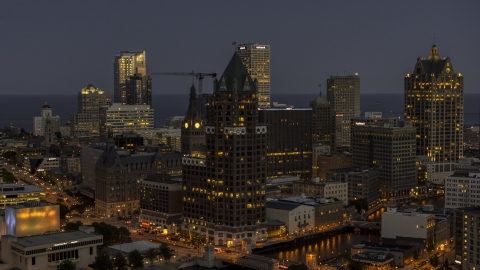 DXP002_151_0001 - Aerial stock photo of A riverfront office tower at night, Downtown Milwaukee, Wisconsin
