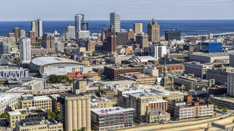 DXP002_152_0003 - Aerial stock photo of The city's skyline and arena in Downtown Milwaukee, Wisconsin, seen from industrial buildings