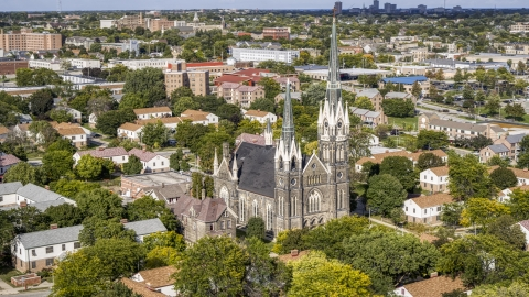 DXP002_152_0005 - Aerial stock photo of A church with tall steeples in Milwaukee, Wisconsin