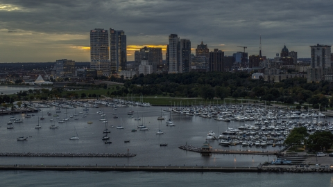 DXP002_155_0003 - Aerial stock photo of Marina and the city's skyline at twilight, Downtown Milwaukee, Wisconsin