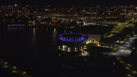 DXP002_157_0003 - Aerial stock photo of Discovery World museum at night, Downtown Milwaukee, Wisconsin