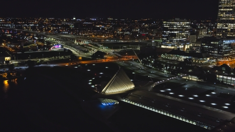 DXP002_157_0006 - Aerial stock photo of The lakefront museum rooftop at night, Downtown Milwaukee, Wisconsin