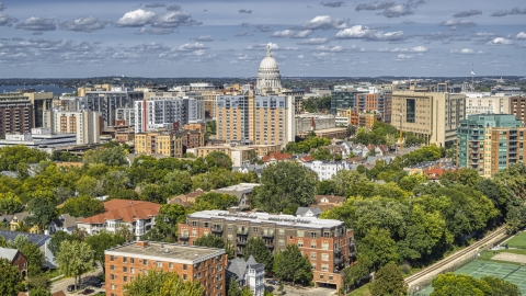 DXP002_158_0002 - Aerial stock photo of A view of apartment buildings near the capitol dome in Madison, Wisconsin