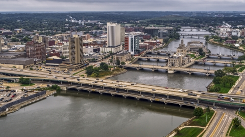 DXP002_164_0005 - Aerial stock photo of Bridges spanning the river by Downtown Cedar Rapids, Iowa