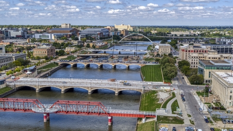 DXP002_165_0006 - Aerial stock photo of A view of of several bridges spanning the river in Des Moines, Iowa