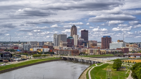 DXP002_165_0011 - Aerial stock photo of The skyline across the river, seen from a park, Downtown Des Moines, Iowa