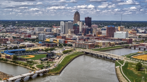 DXP002_165_0014 - Aerial stock photo of The city's skyline across the river, Downtown Des Moines, Iowa