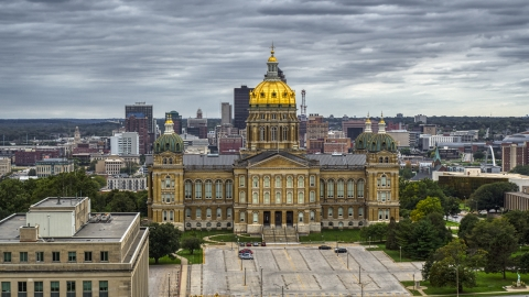 DXP002_165_0021 - Aerial stock photo of The Iowa State Capitol in Des Moines, Iowa in front of the city skyline