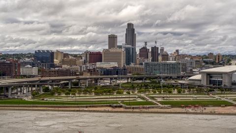 DXP002_168_0002 - Aerial stock photo of A view across the Missouri River toward the city skyline, Downtown Omaha, Nebraska