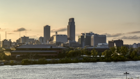 DXP002_172_0006 - Aerial stock photo of The skyline at sunset, seen from the river, Downtown Omaha, Nebraska