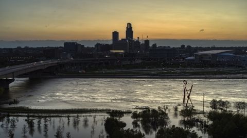 DXP002_172_0014 - Aerial stock photo of The skyline seen from the river at twilight, Downtown Omaha, Nebraska