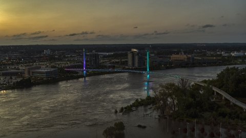 DXP002_172_0016 - Aerial stock photo of A pedestrian bridge spanning the Missouri River at twilight, Omaha, Nebraska