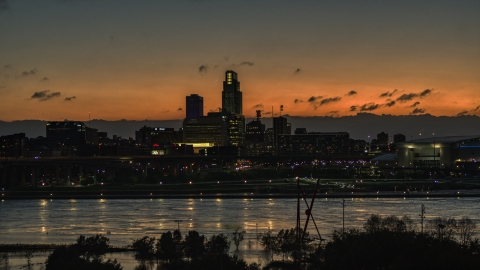 DXP002_173_0001 - Aerial stock photo of A view over the river toward the skyline at twilight, Downtown Omaha, Nebraska