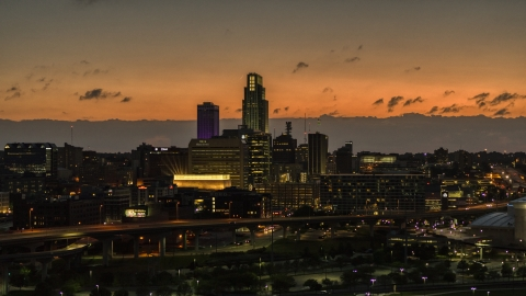 DXP002_173_0003 - Aerial stock photo of A view of skyscrapers in the skyline at twilight, Downtown Omaha, Nebraska
