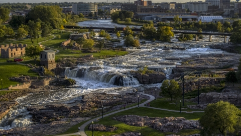 DXP002_176_0003 - Aerial stock photo of The waterfalls at Falls Park at sunset in Sioux Falls, South Dakota