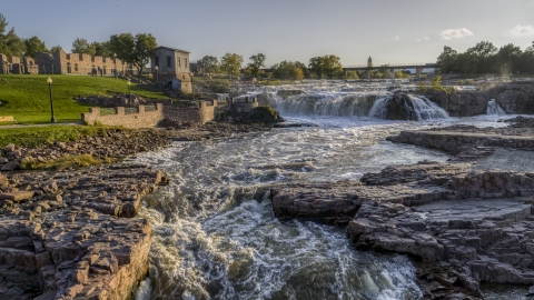 DXP002_176_0004 - Aerial stock photo of A view of waterfalls at sunset in Sioux Falls, South Dakota