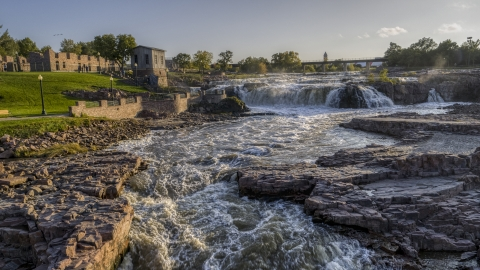 DXP002_176_0005 - Aerial stock photo of A low view of waterfalls at sunset in Sioux Falls, South Dakota