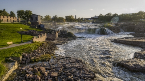 DXP002_176_0006 - Aerial stock photo of A view of the waterfalls at sunset in Sioux Falls, South Dakota