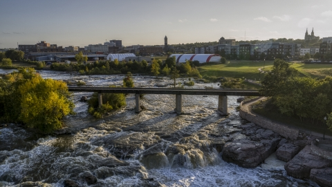 DXP002_176_0007 - Aerial stock photo of A bridge spanning the river at sunset in Sioux Falls, South Dakota