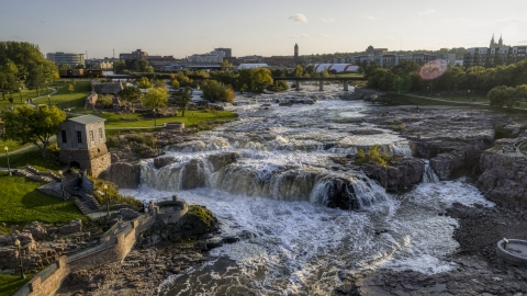 DXP002_176_0009 - Aerial stock photo of The waterfalls on Big Sioux River at sunset in Sioux Falls, South Dakota
