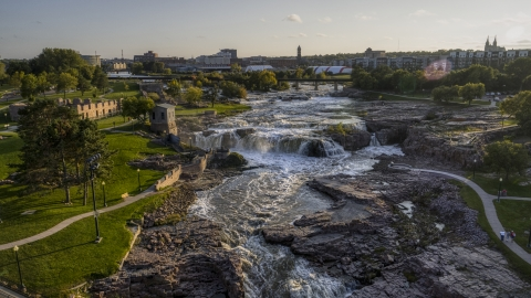 DXP002_176_0010 - Aerial stock photo of A view of Big Sioux River waterfalls at sunset in Sioux Falls, South Dakota