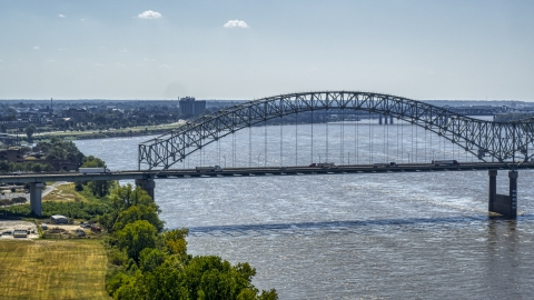 DXP002_177_0003 - Aerial stock photo of A bridge spanning the Mississippi River, Memphis, Tennessee