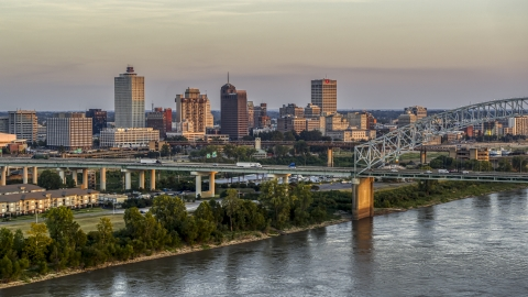 DXP002_181_0002 - Aerial stock photo of The city's skyline behind the bridge at sunset, Downtown Memphis, Tennessee