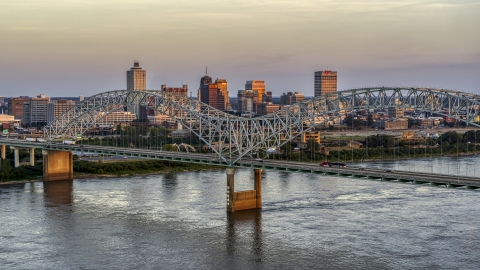 DXP002_181_0003 - Aerial stock photo of The city's skyline as traffic crosses the bridge at sunset, Downtown Memphis, Tennessee
