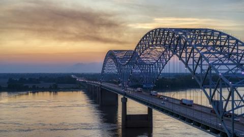 DXP002_181_0005 - Aerial stock photo of The Hernando de Soto Bridge at sunset, Arkansas