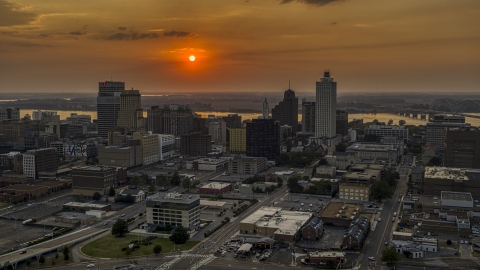DXP002_186_0002 - Aerial stock photo of The city skyline and the setting sun, Downtown Memphis, Tennessee