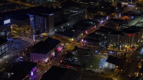 DXP002_188_0001 - Aerial stock photo of Bright lights and signs down Beale Street at nighttime, Downtown Memphis, Tennessee