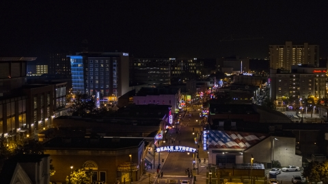 DXP002_188_0002 - Aerial stock photo of Busy Beale Street at nighttime, Downtown Memphis, Tennessee