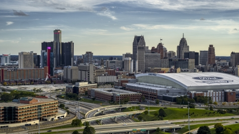DXP002_191_0007 - Aerial stock photo of The football stadium and the city skyline at sunset in Downtown Detroit, Michigan