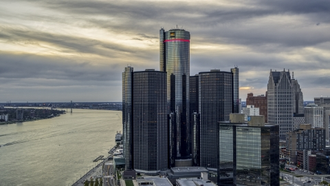 DXP002_192_0008 - Aerial stock photo of A towering riverfront skyscraper at sunset, Downtown Detroit, Michigan