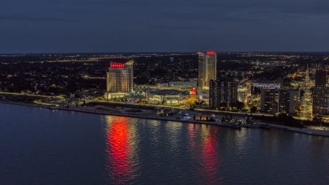 DXP002_193_0006 - Aerial stock photo of The Caesar Windsor hotel and casino across the river at night, Windsor, Ontario, Canada