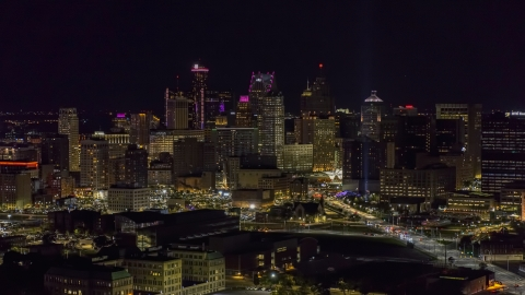 DXP002_193_0012 - Aerial stock photo of The skyline at the end of Grand River Avenue at night, Downtown Detroit, Michigan