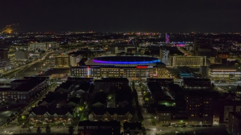 DXP002_193_0013 - Aerial stock photo of Little Caesars Arena at night, Detroit, Michigan